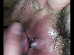 He loves playing with her hairy pussy